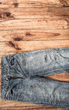 Close up of blue jeans ,Blue Jeans texture on wooden floor. Blue Jeans texture on wooden floor Stock Images