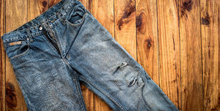 Close up of blue jeans ,Blue Jeans texture on wooden floor. Blue Jeans texture on wooden floor Stock Photography