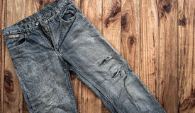 Close up of blue jeans ,Blue Jeans texture on wooden floor. Blue Jeans texture on wooden floor Royalty Free Stock Images