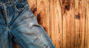 Close up of blue jeans ,Blue Jeans texture on wooden floor. Blue Jeans texture on wooden floor Stock Photo