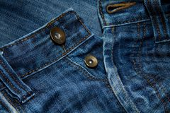 Close up of blue jeans with buttons stock photos