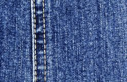 Close-up of the blue jeans cloth Royalty Free Stock Photos