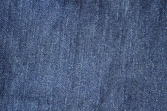 Close up blue jeans fabric background or texture Royalty Free Stock Photography