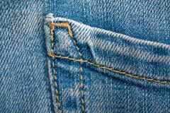 Close-up of blue jeans pocket. Denim texture, macro background for web site or mobile devices.  Royalty Free Stock Images