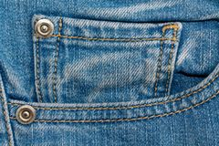 Close-up of blue jeans pocket. Denim texture, macro background for web site or mobile devices.  Stock Photography