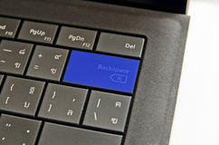 Close up blue keyboard backspace button. Royalty Free Stock Photo
