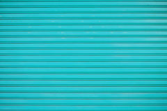 Close up blue metal sheet slide door texture background. Royalty Free Stock Image