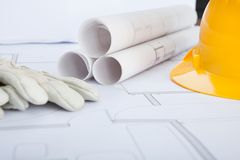 Close-up of blue print and hard hat Stock Image
