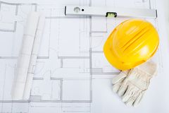 Close-up of blue print and hard hat Royalty Free Stock Photos