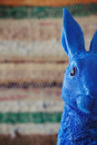 Close up of blue rabbit easter bunny peeking into frame. With clear space for text Stock Photography