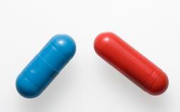 Close-up of blue and red medicine pills Stock Photos