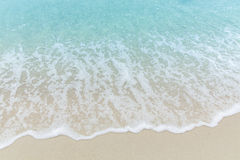 Close up blue sea water waves on white sand beach,Beautiful blue. Sea beach with white sand, Beautiful blue ocean beach close up shot, Clean beach with blue sea Stock Photo