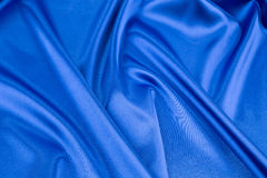 Close up of blue silk. Texture. Royalty Free Stock Image