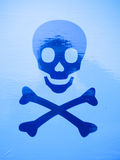 Close up of blue skull and bones skeleton print. England; UK Stock Images