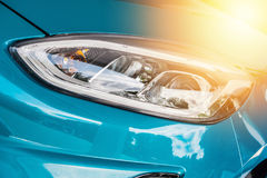 Close up of a blue sport car in sunset Royalty Free Stock Image