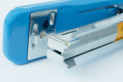 Close up blue stapler and staple Royalty Free Stock Image
