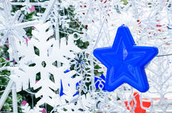 Close up blue star hanging with snowflake ,Holiday concept Stock Image