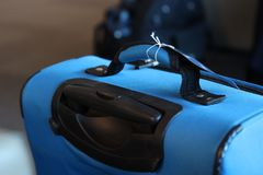 Carry on baggage. A close up of a blue suitcase with luggage tag ready to carry on the plane Royalty Free Stock Photos