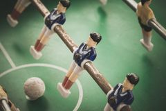 Close up of blue table soccer foosbal players. Table football players and ball Stock Image
