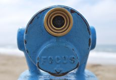 Close up blue telescope view point looking out to sea Royalty Free Stock Photo