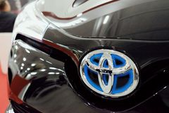 Close up blue Toyota logo on black car stock photos