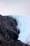 CLOSE UP BLUE AND WHITE GLACIER AND BLACK ROCK Stock Images