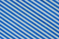 Close up on blue and white line fabric with 30 degree angle Royalty Free Stock Photography