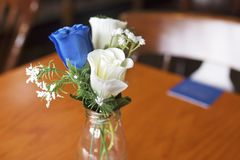 Close up of blue and white roses as a table decoration in a smal Royalty Free Stock Photography