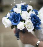 Close up of a blue and white wedding bouquet held by bride. In the UK Stock Image