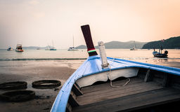 Close up a blue wooden boat on the beach Stock Photos