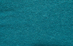 Close up blue woollen knitted fabric texture. Angora background Royalty Free Stock Image