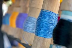 Close up Blue yarn focused wrapped around bamboo tube royalty free stock photos