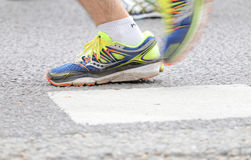 Close up of the blue and yellow shoes of a male runner Stock Photography