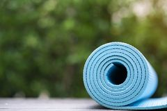 Close up of blue yoga mat on the table Stock Photography