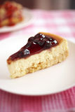 Close up blueberry cheese cake and blueberry sauce Royalty Free Stock Photo
