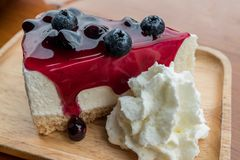 Blueberry cheese cake with whipping cream stock image