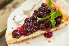 Blueberry cheesecake. Close up blueberry cheesecake slice on the wood table Stock Photography