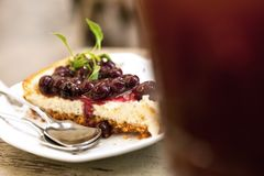 Blueberry cheesecake. Close up blueberry cheesecake slice on the wood table Stock Photo