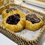 Close up of Blueberry Pies in basket at bakery shop Royalty Free Stock Photography