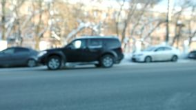 Close-up blur of cars and bus traveling on the road in winter. Road asphalt without snow. Close-up blur of cars and bus traveling on the road in winter. Road stock footage