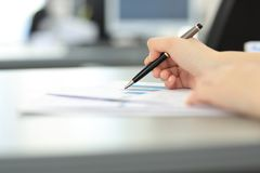 Close up. blurred image of a business woman at her Desk royalty free stock photos