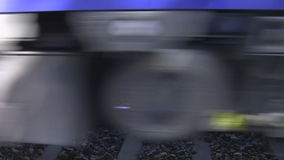 Close up of blurry train wheels. Speed. Abstract shot of blurry wheels of the passing train stock video