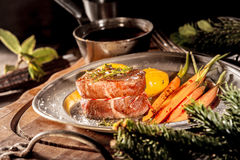 Close Up of Boar Filet Steak on Plate with Veggies Stock Photos
