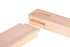 Close-up of boards with woodworking mortises and a tenon isolate Stock Image
