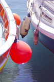 Close up of boats standing besides each other with buoys Royalty Free Stock Photos
