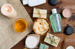Close up of body care cosmetic products on wood Royalty Free Stock Images