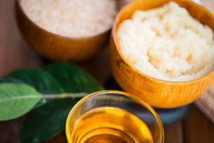 Close up of body scrub in wooden bowl. Beauty, spa, body care, natural cosmetics and wellness concept - close up of body scrub in wooden bowl Stock Photography