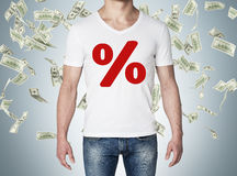 Close up of the body view of the man in a white t-shirt with the red percentage sign on the chest. Concept of the sale. Falling do Royalty Free Stock Photo