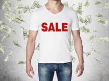 Close up of the body view of the man in a white t-shirt with the red word ' sale ' on the chest. Concept of the sale. Royalty Free Stock Photo