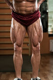 Close-Up of Bodybuilders Legs Ready For Competitive Sport Stock Photography